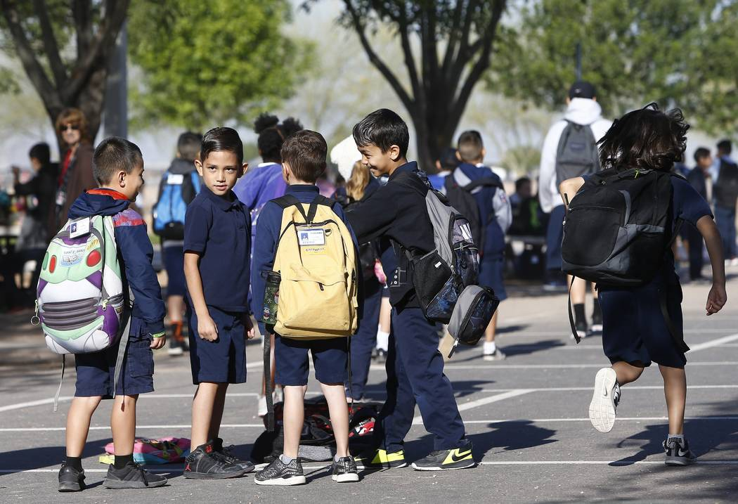 Students at Tuscano Elementary School wait in the school playground for class to start as several Arizona schools resume classes Thursday, May 3, 2018, in Phoenix. After an all night legislative b ...