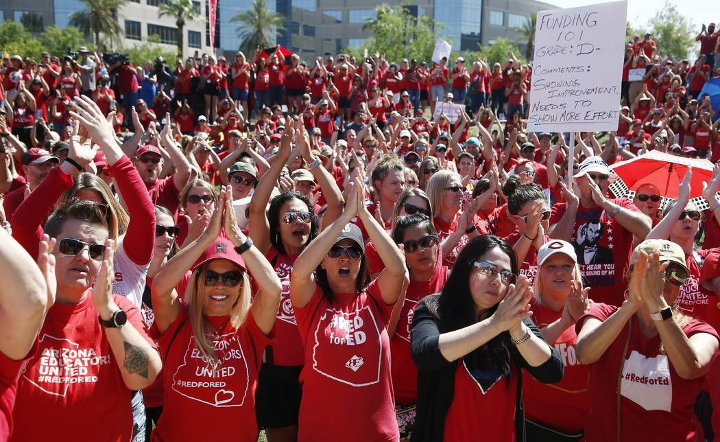 Teachers chant as they continue to protest at the Arizona Capitol Thursday, May 3, 2018, in Phoenix. After an all night legislative budget session the legislature passed the new education spending ...