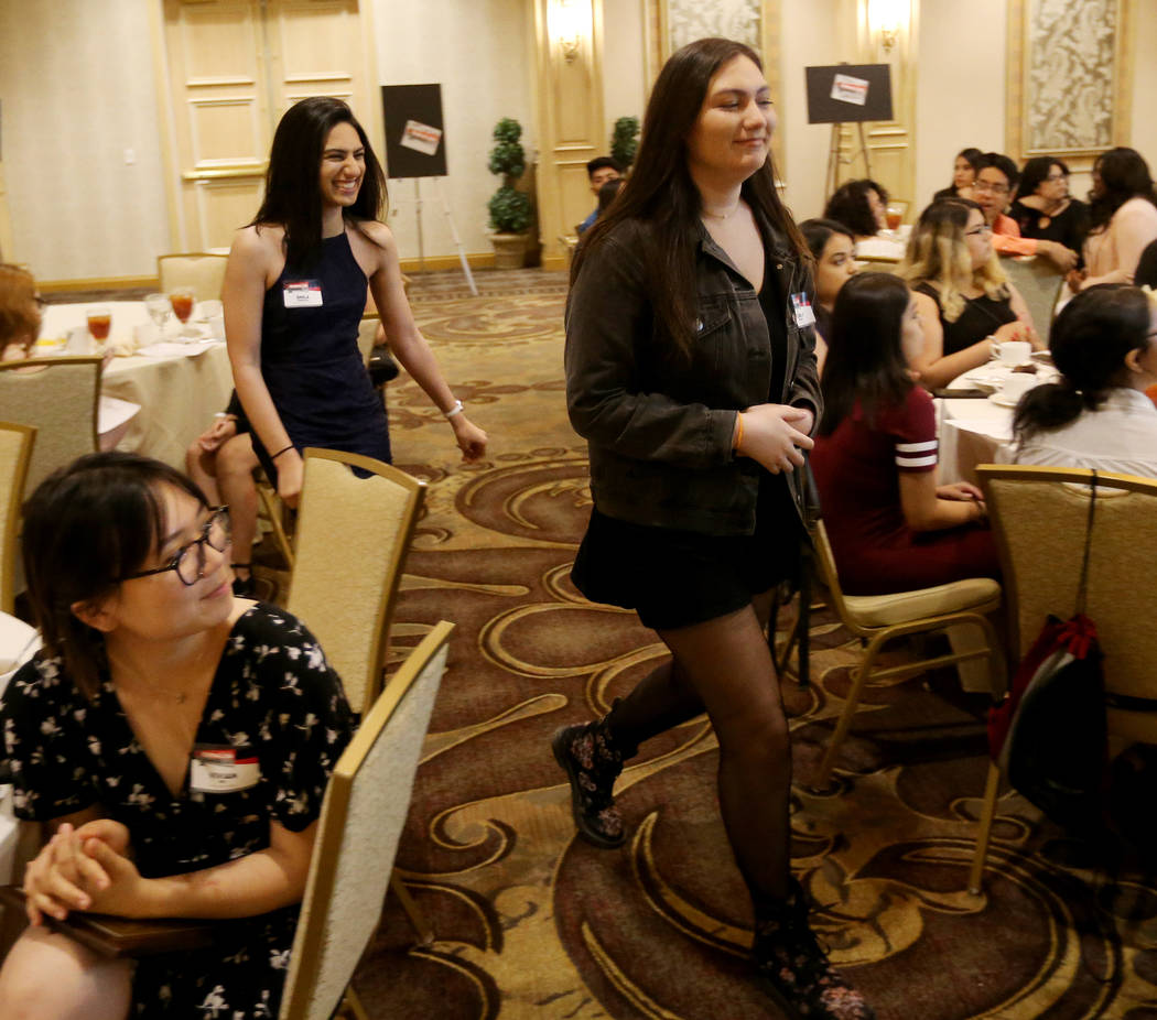 Green Valley High School The InvestiGator co-editor Shila Sherafat, left, and reporter Nora-Jo Paramo go up to receive the award for Best Newspaper / Reduced format at the Las Vegas Review-Journal ...