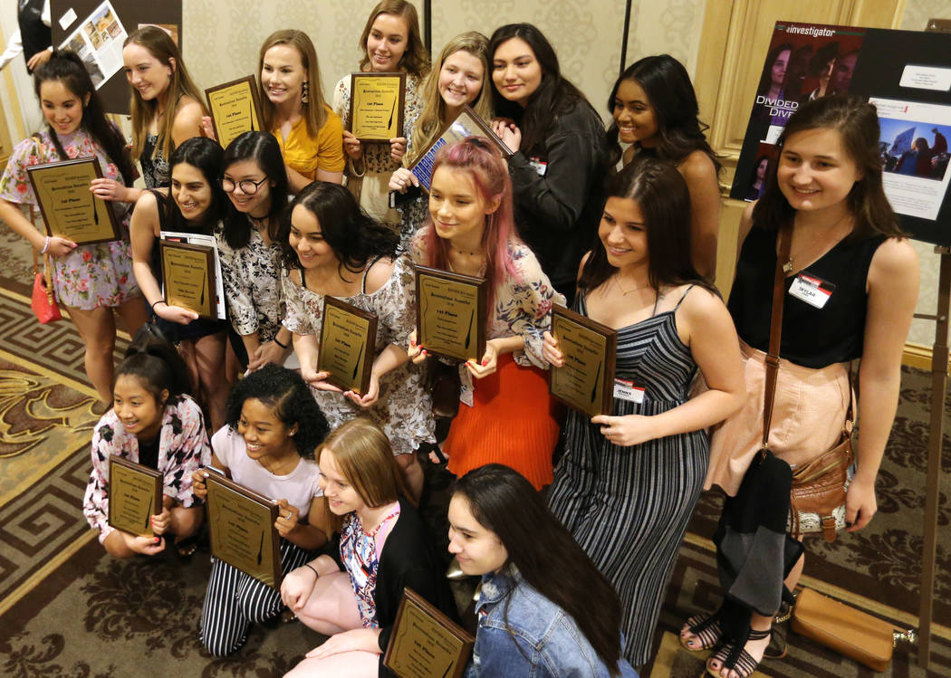 Staff members of the Green Valley High School The InvestiGator show their awards at the Las Vegas Review-Journal High School Journalism Awards at the Suncoast in Las Vegas Monday, May 7, 2018. K.M ...