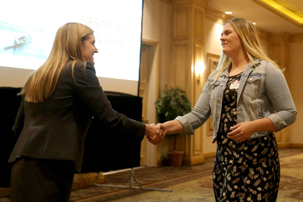 Elly Davis, of Foothill High School, receives her award for Best Sports Page Design from Metro Editor Carri Geer Thevenot at the Las Vegas Review-Journal High School Journalism Awards at the Sunco ...