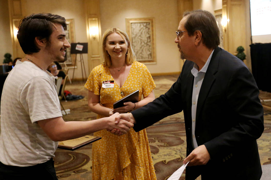 John Blake and Meagan Shaffer, of Las Vegas Academy, receive their award for Best Page One design / Reduced Format from Bill Bradley, assistant managing editor, sports, at the Las Vegas Review-Jou ...