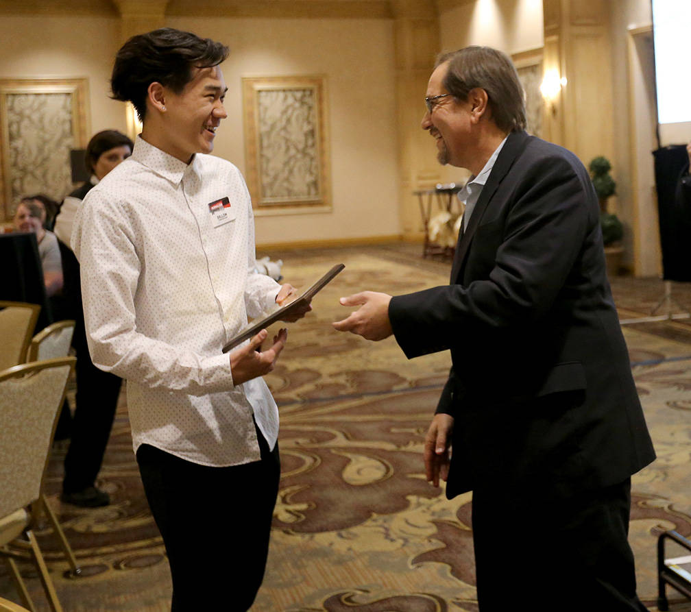 Dillon Concepcion, of Spring Valley High School, receives his award for Best Editorial from Bill Bradley, assistant managing editor, sports, at the Las Vegas Review-Journal High School Journalism ...