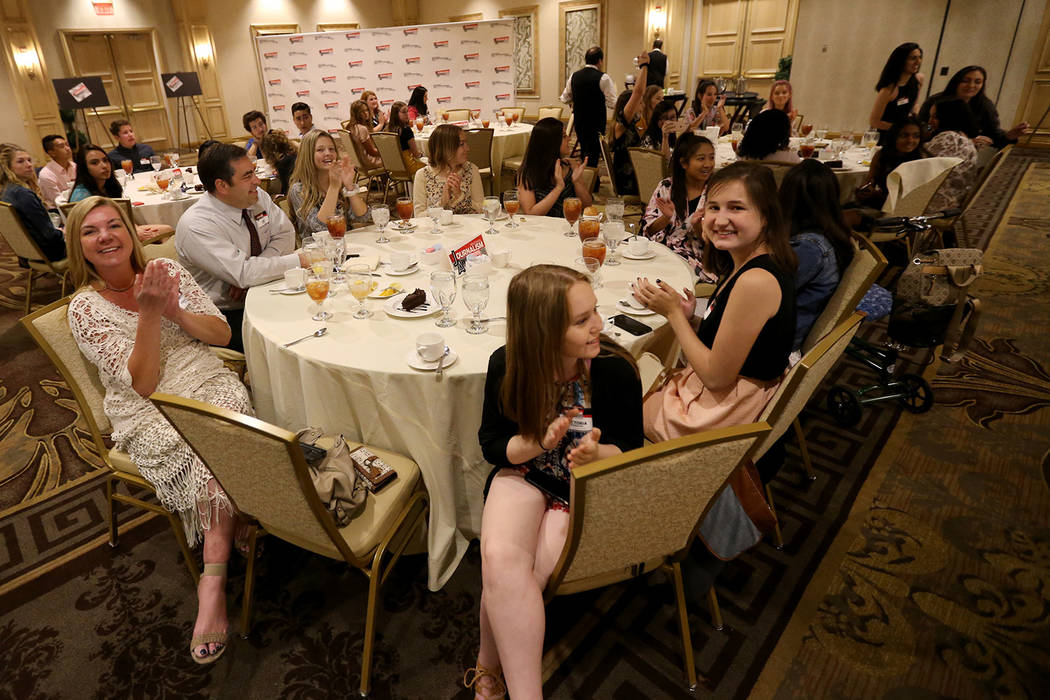 Staff members of the Green Valley High School The InvestiGator react to receiving the award for Best Newspaper / Reduced format at the Las Vegas Review-Journal High School Journalism Awards at the ...