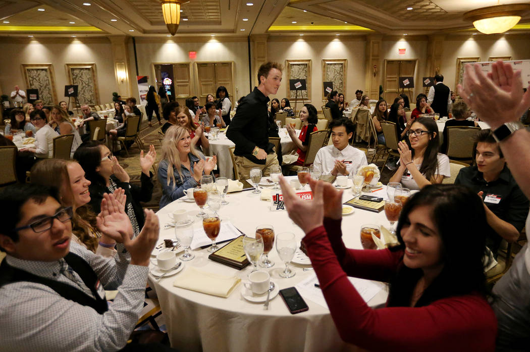 Spring Valley High School The Grizzly Growler Editor-in-Chief Donovan Souder goes up to receive the award for Best Newspaper / Standard Format at the Las Vegas Review-Journal High School Journalis ...