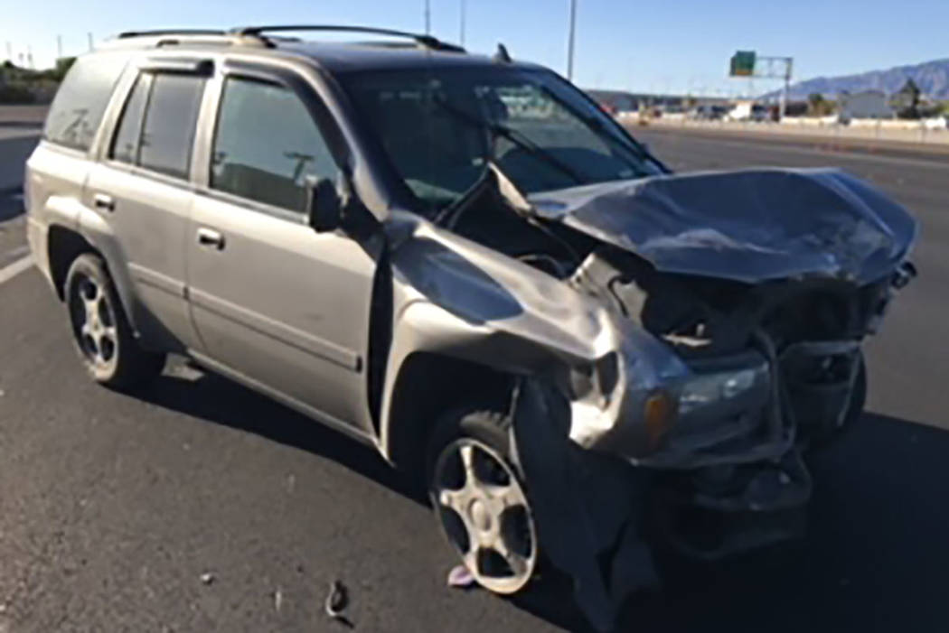 A gray Chevrolet Trailblazer, seen at the site of a fatal traffic crash on U.S. 95 southbound (north of Ann Road) in Las Vegas on Friday. (Nevada Highway Patrol)