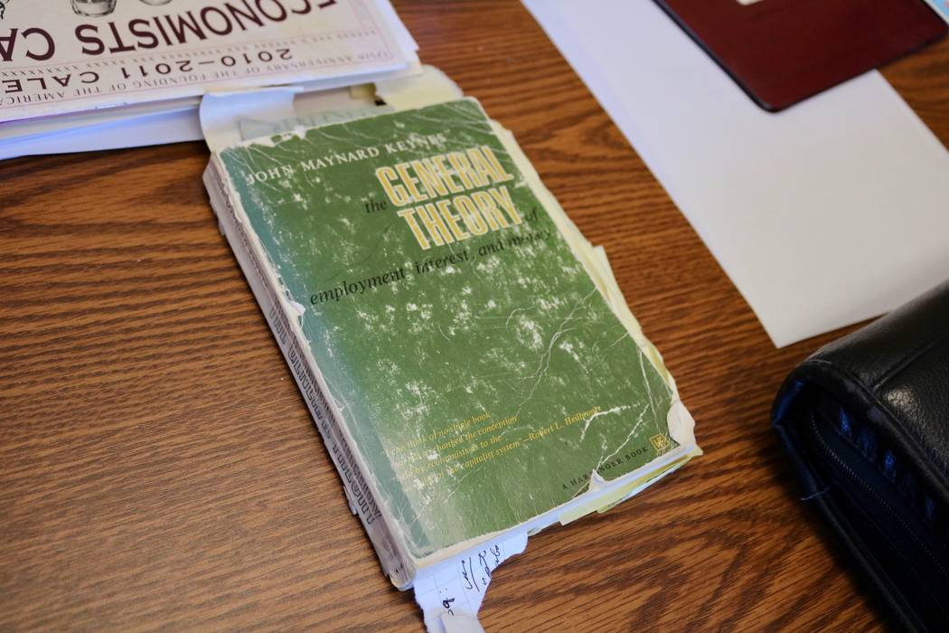 "A well-worn copy of ""The General Theory of Employment, Interest and Money"" by John Maynard Keynes sits on the desk of Professor Bernard Malamud in his office at the Lee Business School a ..."