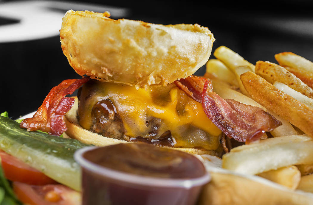 The Texan Burger with cheddar cheese, crispy onion ring, bacon, mayo and Sweet Baby Ray's BBQ sauce at Black Tap on Monday, May 7, 2018, at The Venetian hotel-casino, in Las Vegas. Benjamin Hager ...