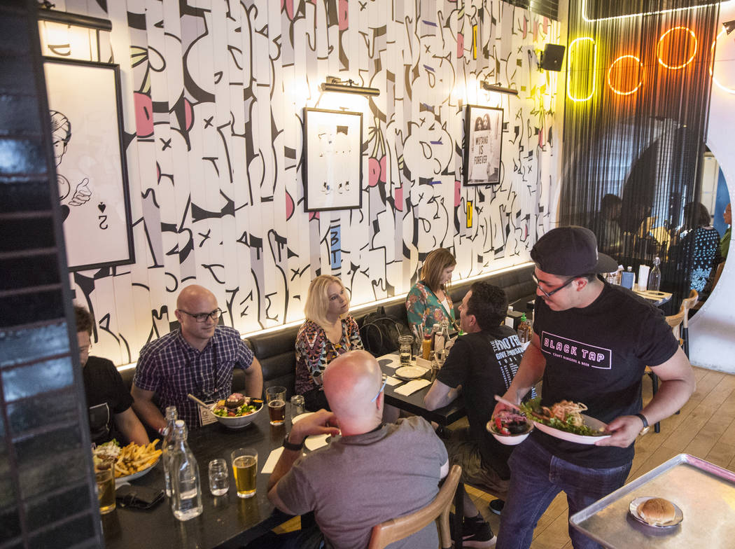 Dinners enjoy lunch at Black Tap on Monday, May 7, 2018, at The Venetian hotel-casino, in Las Vegas. Benjamin Hager Las Vegas Review-Journal @benjaminhphoto