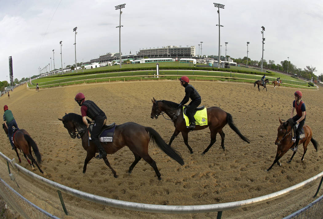 Kentucky Derby entrant Mendelssohn trains along with a group of outriders at Churchill Downs Thursday, May 3, 2018, in Louisville, Ky. The 144th running of the Kentucky Derby is scheduled for Satu ...