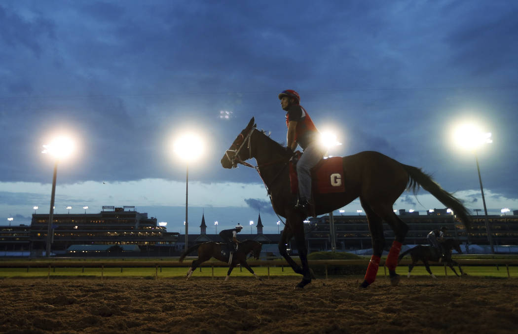 Horses train for the 144th running of the Kentucky Derby horse race at Churchill Downs Friday, May 4, 2018, in Louisville, Ky. (AP Photo/John Minchillo)