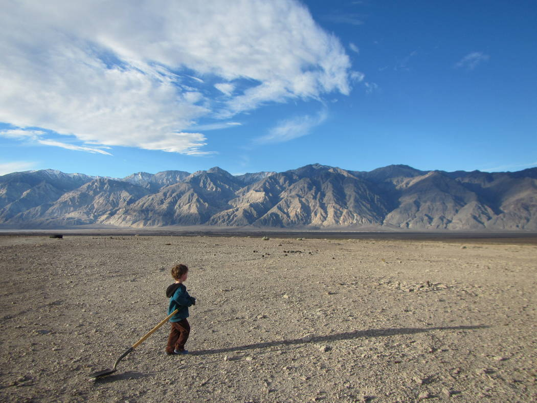 A boy plays with a shovel in Saline Valley at Death ValleyNational Park on Jan. 18, 2015. Henry Brean Las Vegas Review-Journal