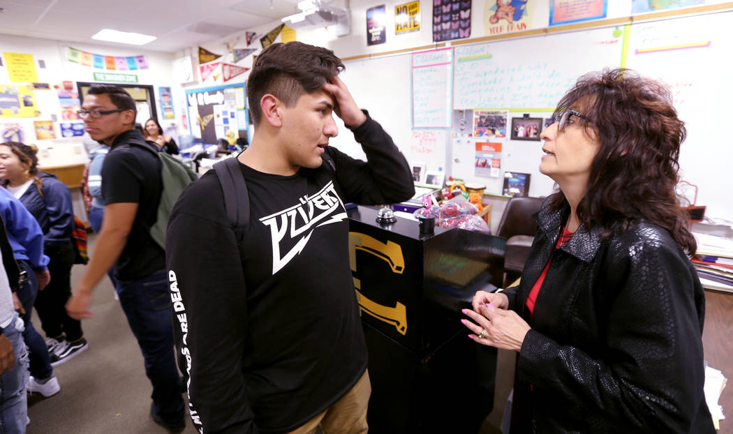 Clark High School teacher Luanne Wagner talks to senior Brandon Cera before a meeting of the KEEN Club Wednesday, May 2, 2018. Wagner is the club advisor for Keeping Everyone's Eyes on the Neighbo ...