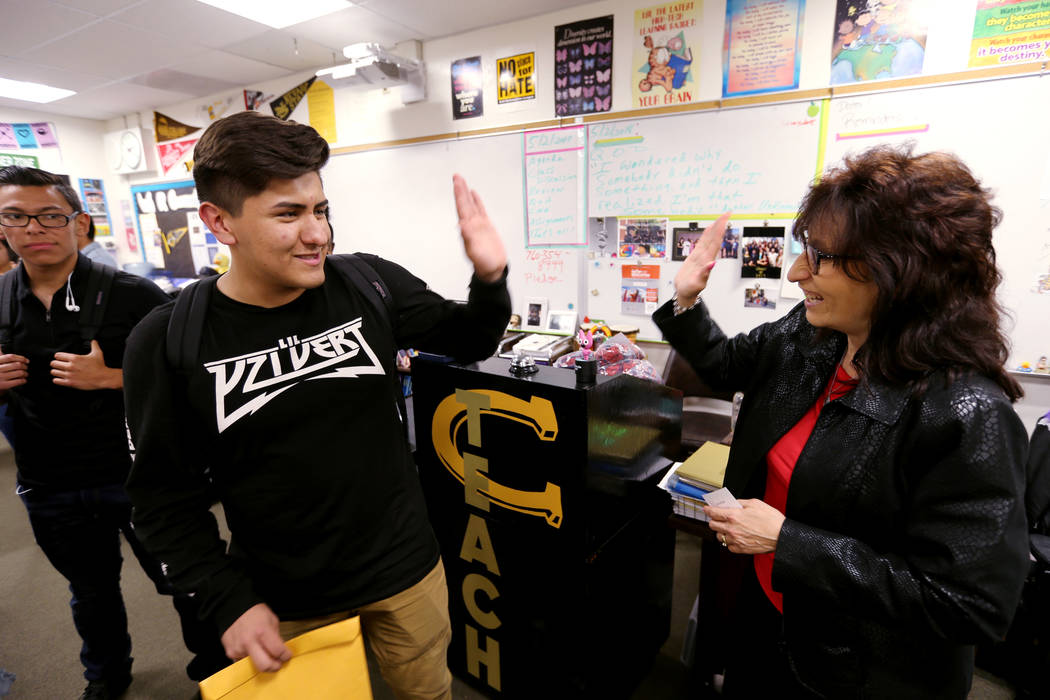 Clark High School teacher Luanne Wagner high-fives senior Brandon Cera before a meeting of the KEEN Club Wednesday, May 2, 2018. Wagner is the club advisor for Keeping Everyone's Eyes on the Neigh ...