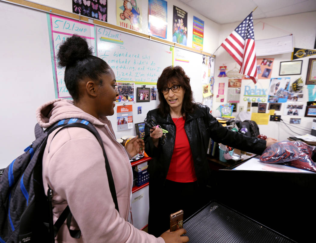 Clark High School teacher Luanne Wagner talks to Caprice Williams before a meeting of the KEEN Club Wednesday, May 2, 2018. Wagner is the club advisor for Keeping Everyoneճ Eyes on the Neigh ...