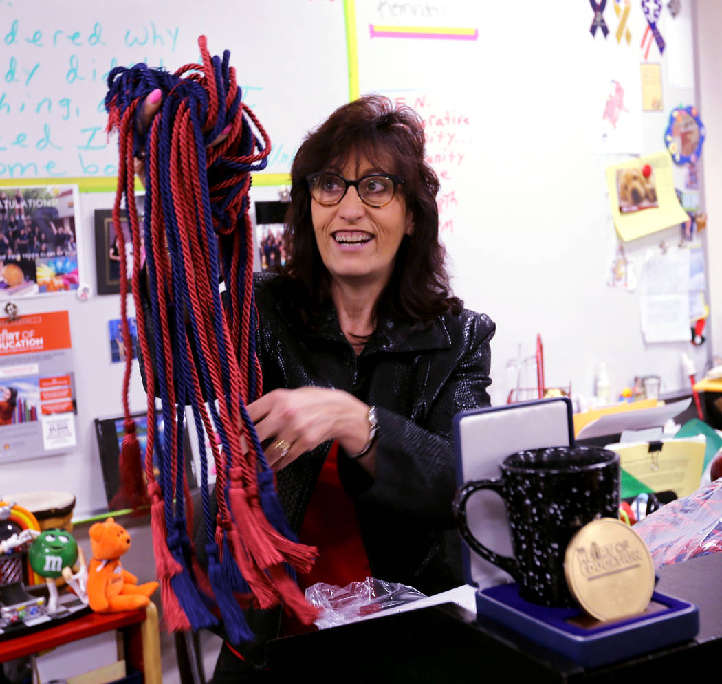 Clark High School teacher Luanne Wagner shows graduation cords before a meeting of the KEEN Club Wednesday, May 2, 2018. Wagner is the club advisor for Keeping Everyone's Eyes on the Neighborhood, ...