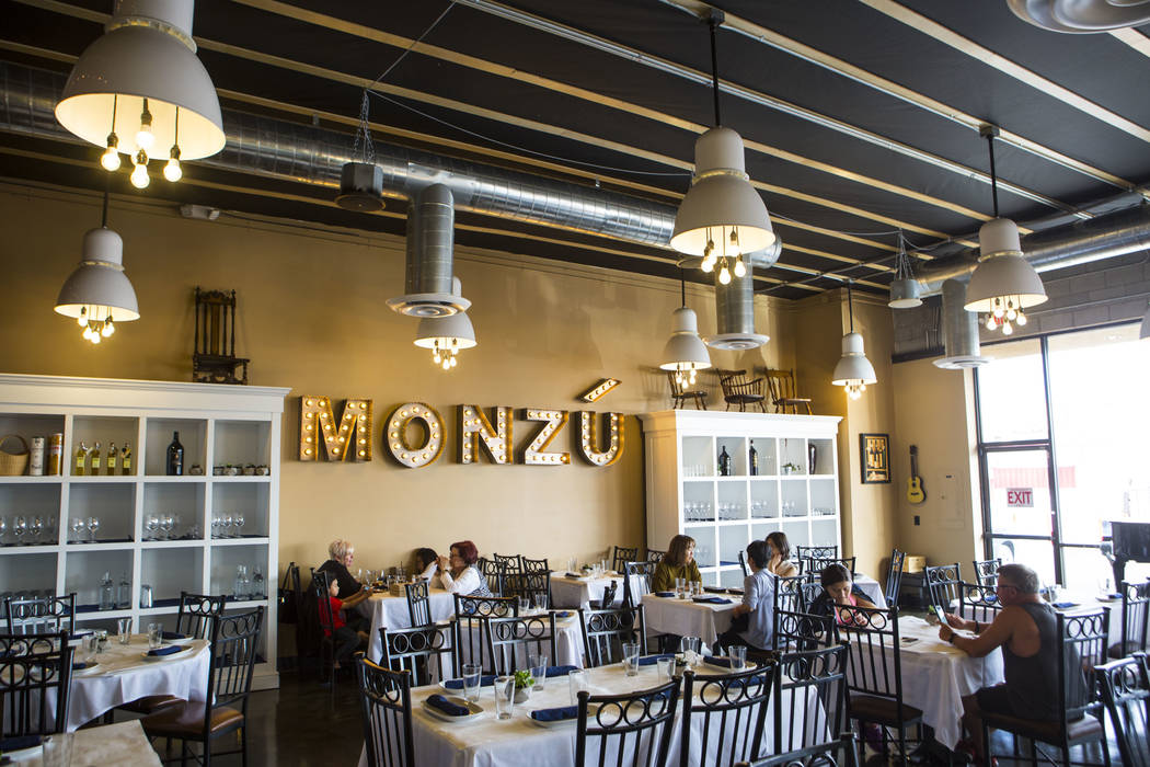 People dine at Pizzeria Monzu, 6020 W. Flamingo Road, in Las Vegas on Saturday, May 5, 2018. Chase Stevens Las Vegas Review-Journal @csstevensphoto