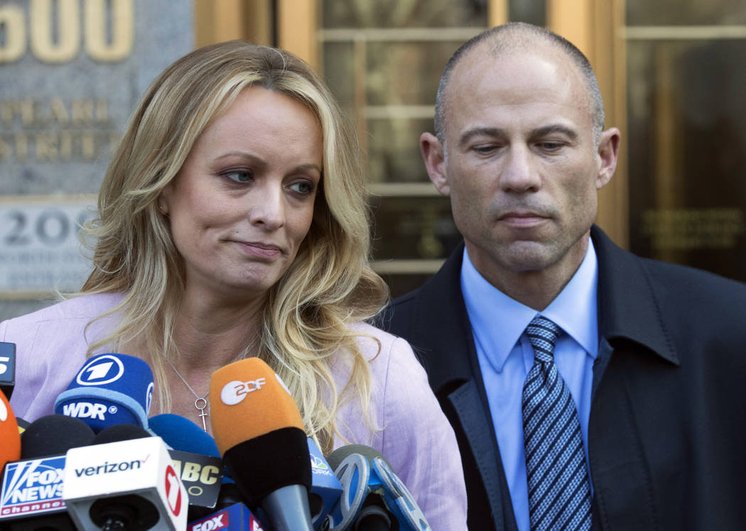 Stormy Daniels, left, stands with her lawyer Michael Avenatti as she speaks outside federal court in New York last month. (AP Photo/Mary Altaffer, File)