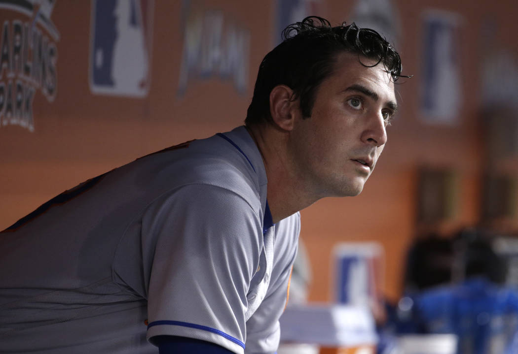 In this Sept. 18, 2017, file photo, New York Mets starting pitcher Matt Harvey sits in the dugout after pitching during the third inning of a baseball game against the Miami Marlins in Miami. (A ...
