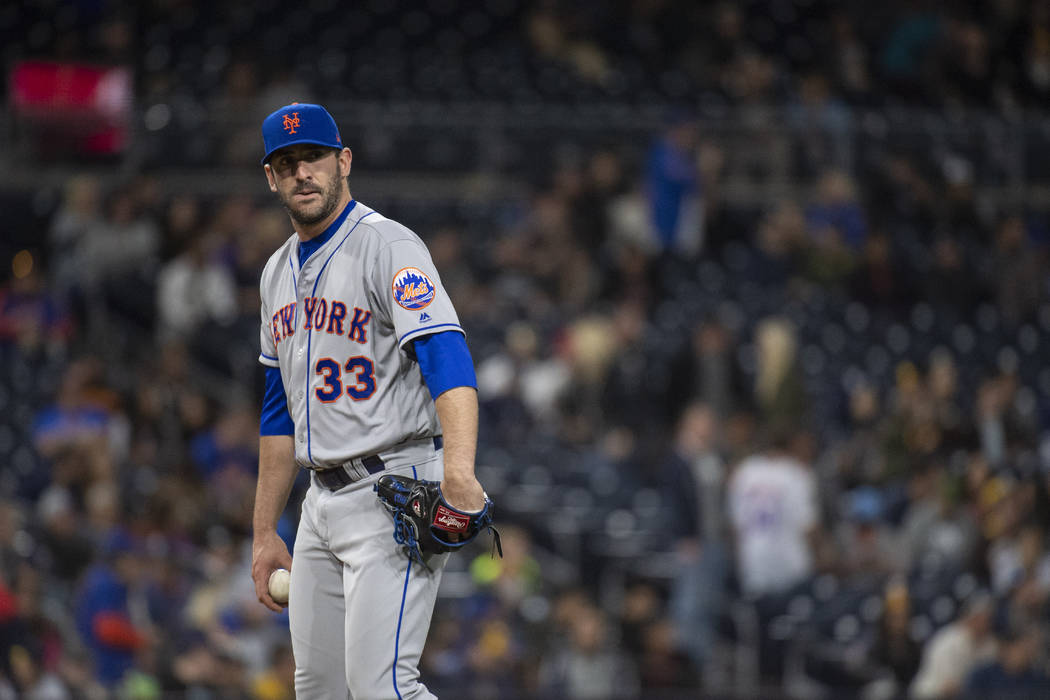 In this Friday, April 27, 2018, file photo, New York Mets relief pitcher Matt Harvey watches during the ninth inning of a baseball game against the San Diego Padres in San Diego. (AP Photo/Kyusung ...