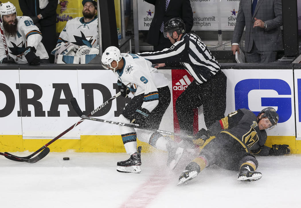 San Jose Sharks left wing Evander Kane (9) gains control of the puck as Golden Knights center Cody Eakin (21) hits the ice during the second period of Game 5 of an NHL hockey second-round playoff ...