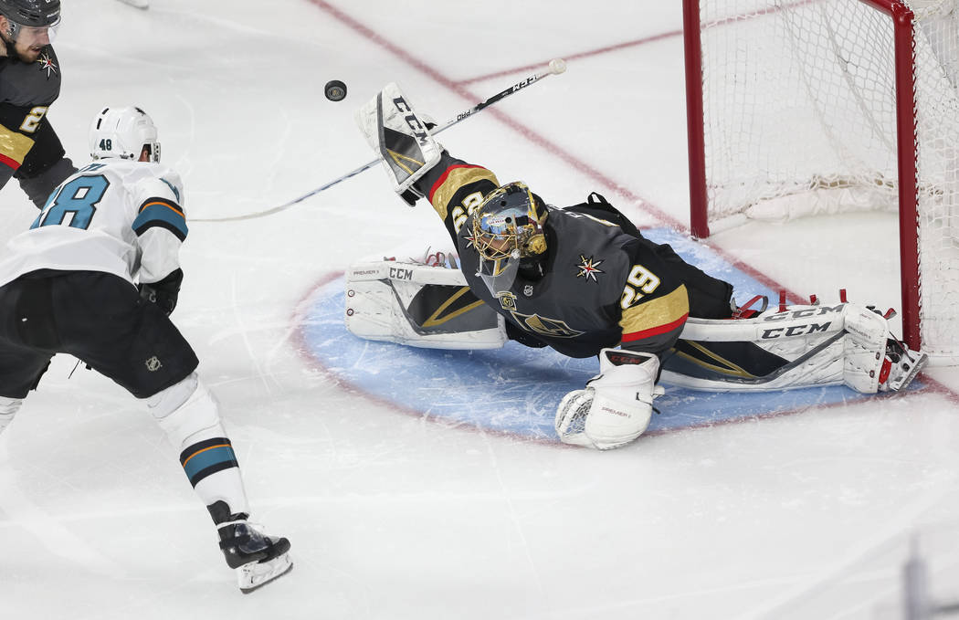 Golden Knights goaltender Marc-Andre Fleury (29) deflects an attempt by San Jose Sharks center Tomas Hertl (48) hird period of Game 5 of an NHL hockey second-round playoff series at T-Mobile Arena ...