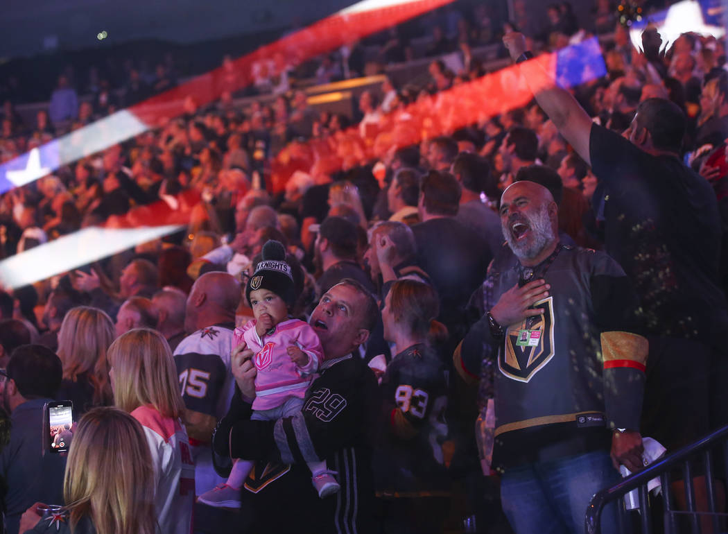 "Golden Knights fans shout ""Knight!"" as the national anthem is performed before the start of Game 5 of an NHL hockey second-round playoff series between the Golden Knights and San Jose Sh ..."