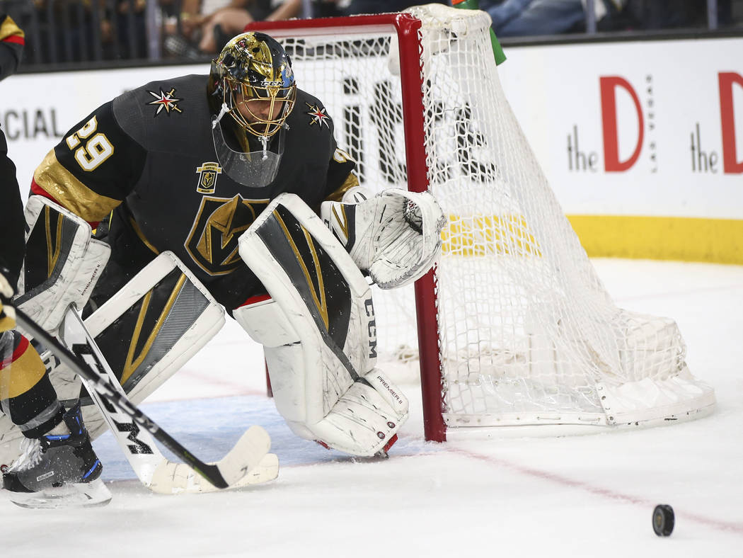 Golden Knights goaltender Marc-Andre Fleury (29) defends against the San Jose Sharks during the second period of Game 5 of an NHL hockey second-round playoff series at T-Mobile Arena in Las Vegas ...