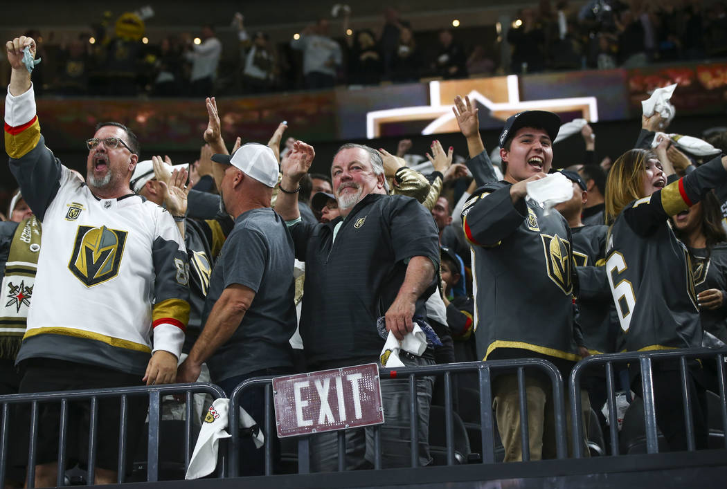 Golden Knights fans celebrate a goal by Alex Tuch, not pictured, during the third period of Game 5 of an NHL hockey second-round playoff series against the San Jose Sharks at T-Mobile Arena in Las ...