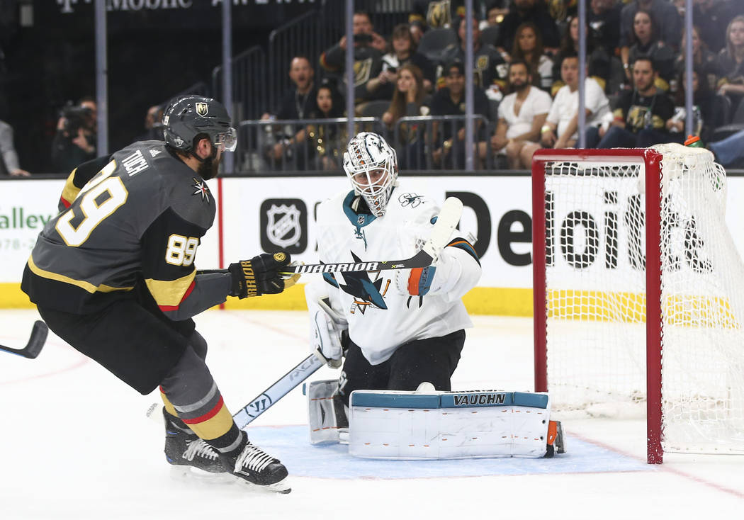 Golden Knights right wing Alex Tuch (89) scores a goal past San Jose Sharks goaltender Martin Jones (31) during the third period of Game 5 of an NHL hockey second-round playoff series at T-Mobile ...