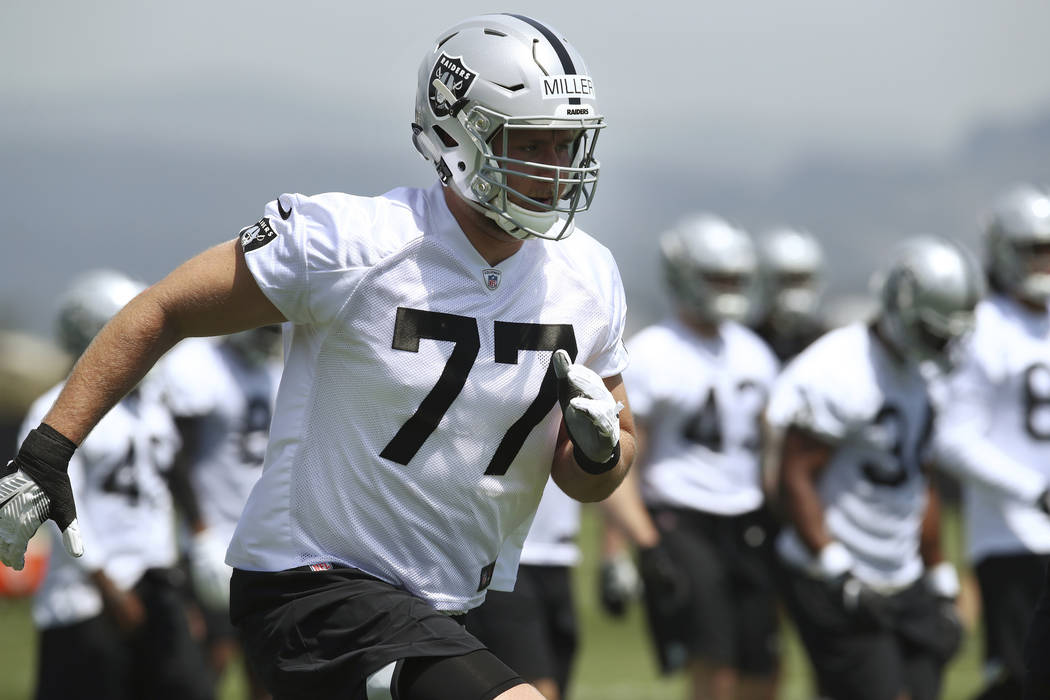 Oakland Raiders' Kolton Miller (77) runs during an NFL football practice on Friday, May 4, 2018, at the team's training facility in Alameda, Calif. (AP Photo/Ben Margot)