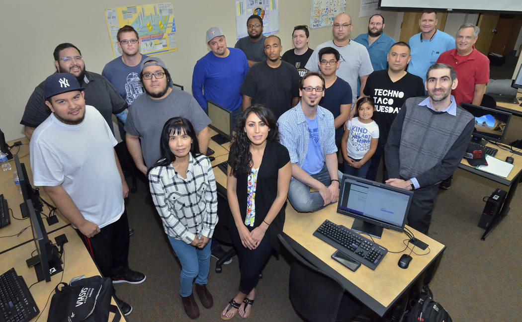 Members of the College of Southern Nevada Cybersecurity Club, including a club memberճ daughter, are shown on the Cheyenne campus at 3200 E. Cheyenne Ave. in North Las Vegas on Friday, May 4 ...