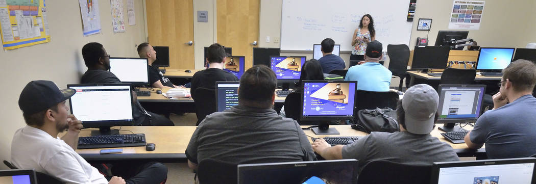 Monique Moreno, background right, speaks during a meeting of the College of Southern Nevada Cybersecurity Club on the Cheyenne campus at 3200 E. Cheyenne Ave. in North Las Vegas on Friday, May 4, ...