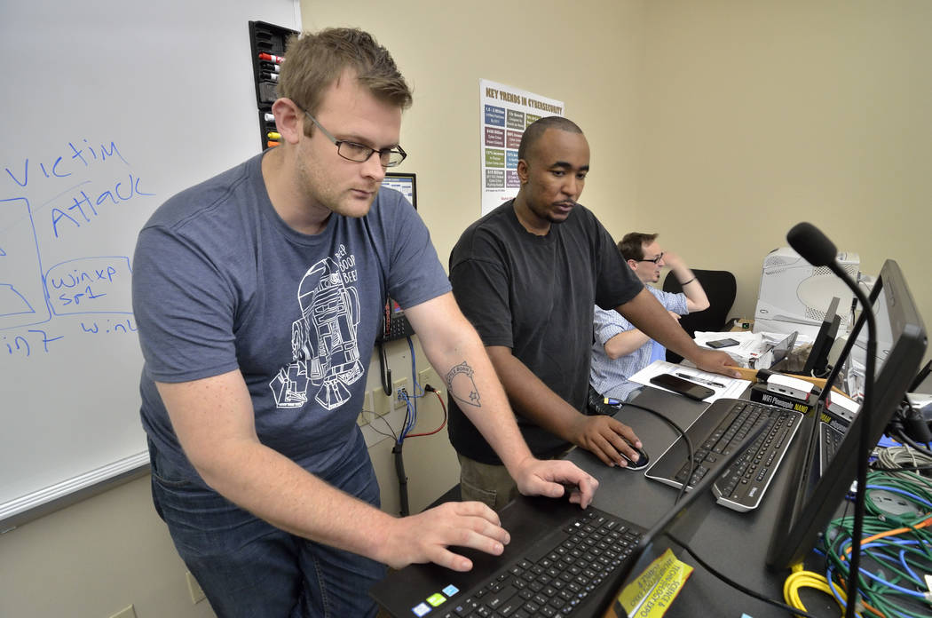 Robert Kaiser, left, and Marcus Hogan prepare to visit the Dark Web on a computer they isolated from the collegeճ network during a meeting of the College of Southern Nevada Cybersecurity Clu ...