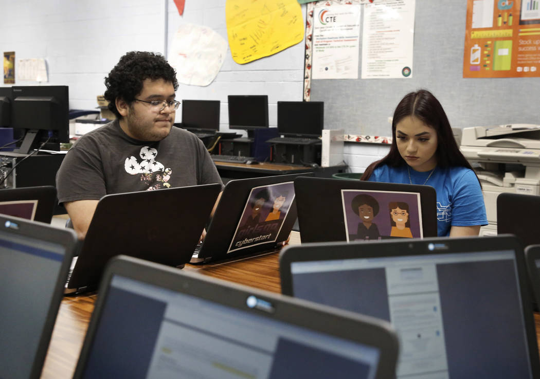Ricardo Torres, 12th-grade student at Cheyenne High School, and 11th-grade student, Ivette Para, work on their project during cyber defense class on Friday, May 18, 2018, in Las Vegas. Bizuayehu T ...
