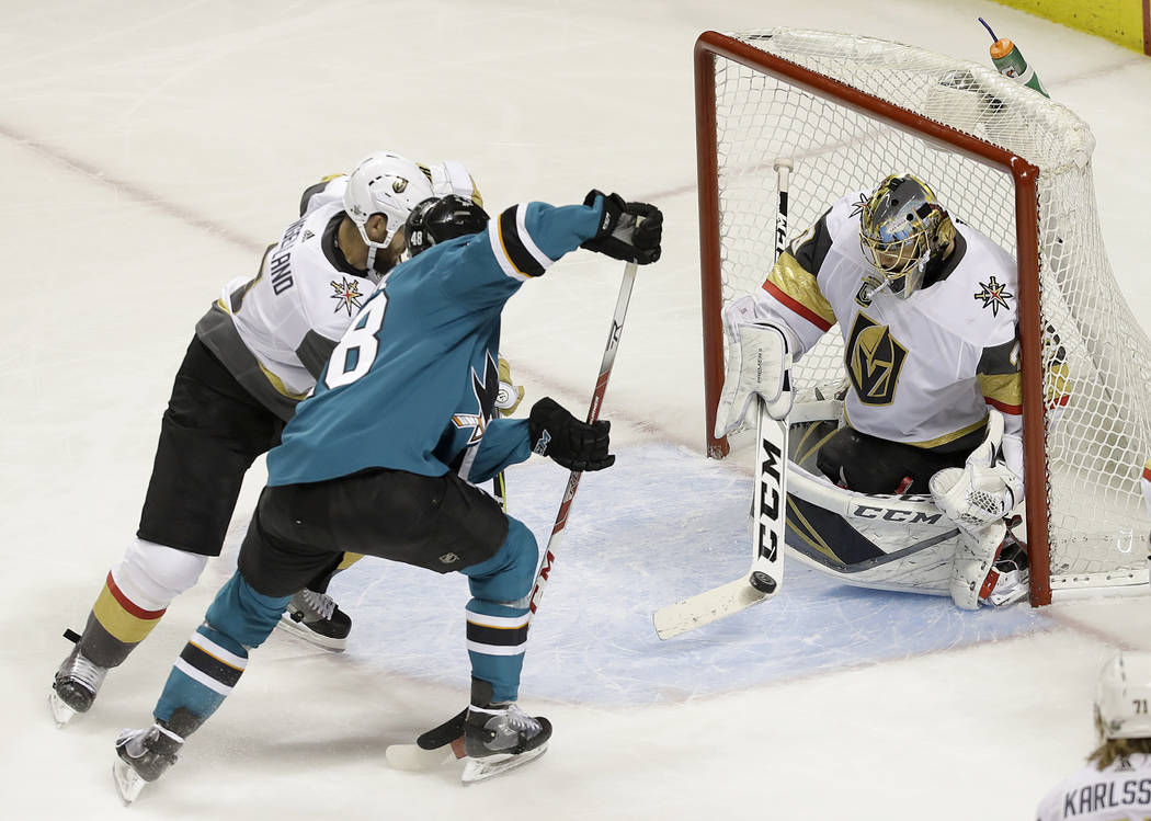 Vegas Golden Knights goaltender Marc-Andre Fleury, right, defends a shot from San Jose Sharks center Tomas Hertl, from the Czech Republic, during Game 4 of an NHL hockey second-round playoff serie ...