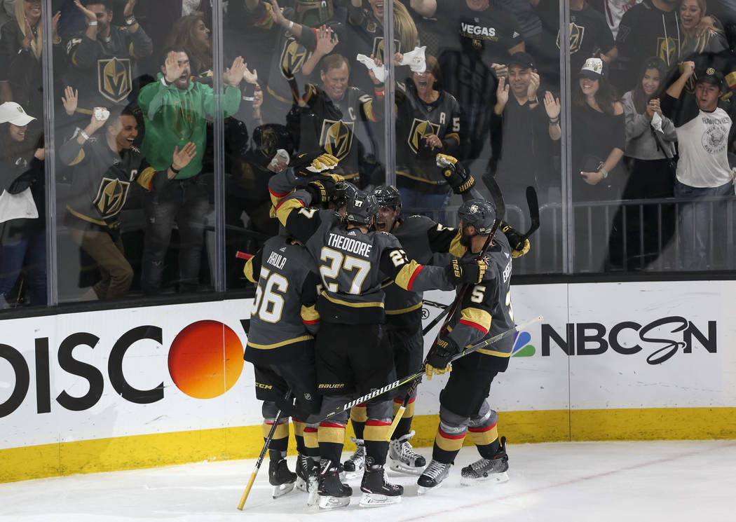 Vegas Golden Knights celebrate a first period goal by James Neal (18) against the San Jose Sharks during Game 5 of an NHL hockey second-round playoff series at T-Mobile Arena in Las Vegas on Frida ...