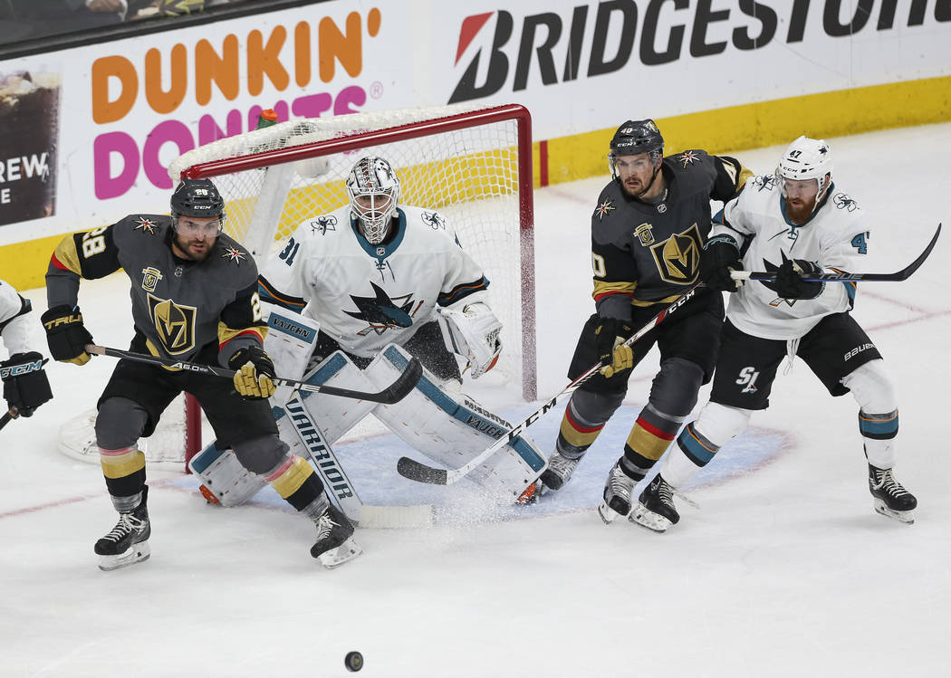 Golden Knights left wing William Carrier, left, and Knights center Ryan Carpenter, second right, look for the pass as San Jose Sharks goaltender Martin Jones (31) and Sharks defenseman Joakim Ryan ...