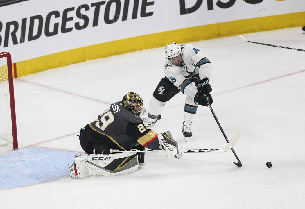 Golden Knights goaltender Marc-Andre Fleury (29) deflects the puck from San Jose Sharks center Eric Fehr (16) during the second period of Game 5 of an NHL hockey second-round playoff series at T-M ...