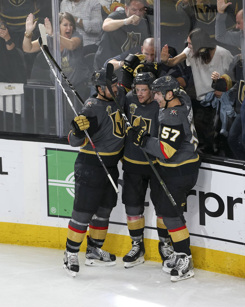 The Golden Knights celebrate a second period goal by Golden Knights left wing Erik Haula (56) against the San Jose Sharks in Game 5 of an NHL hockey second-round playoff series at T-Mobile Arena i ...