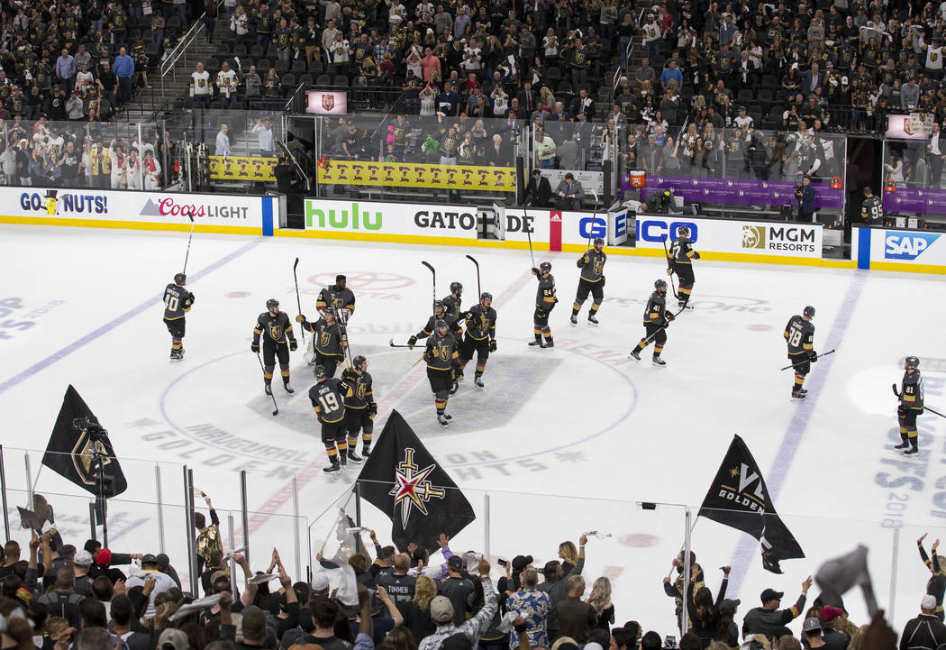 The Vegas Golden Knights celebrate their 5-3 victory over the San Jose Sharks following Game 5 of an NHL hockey second-round playoff series at T-Mobile Arena in Las Vegas on Friday, May 4, 2018. R ...