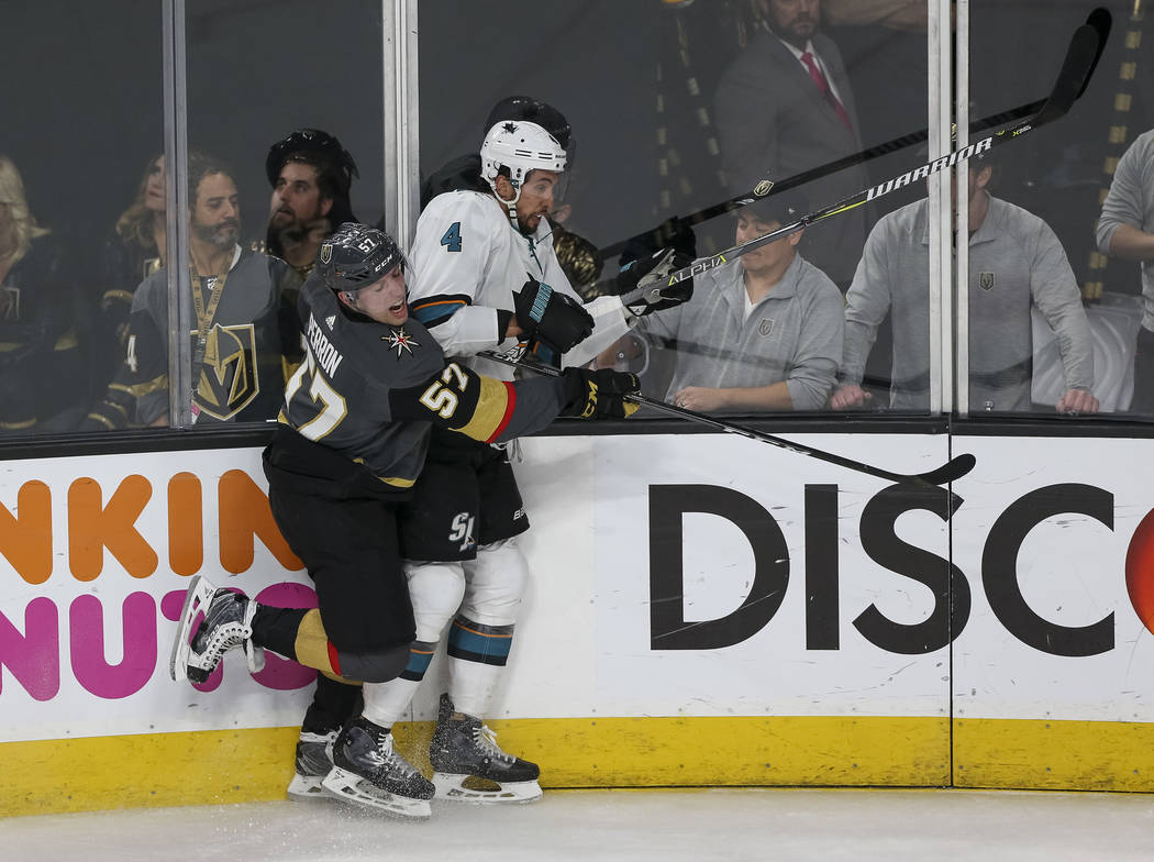 Golden Knights left wing David Perron (57) collides with San Jose Sharks defenseman Brenden Dillon (4) during the second period of Game 5 of an NHL hockey second-round playoff series at T-Mobile A ...