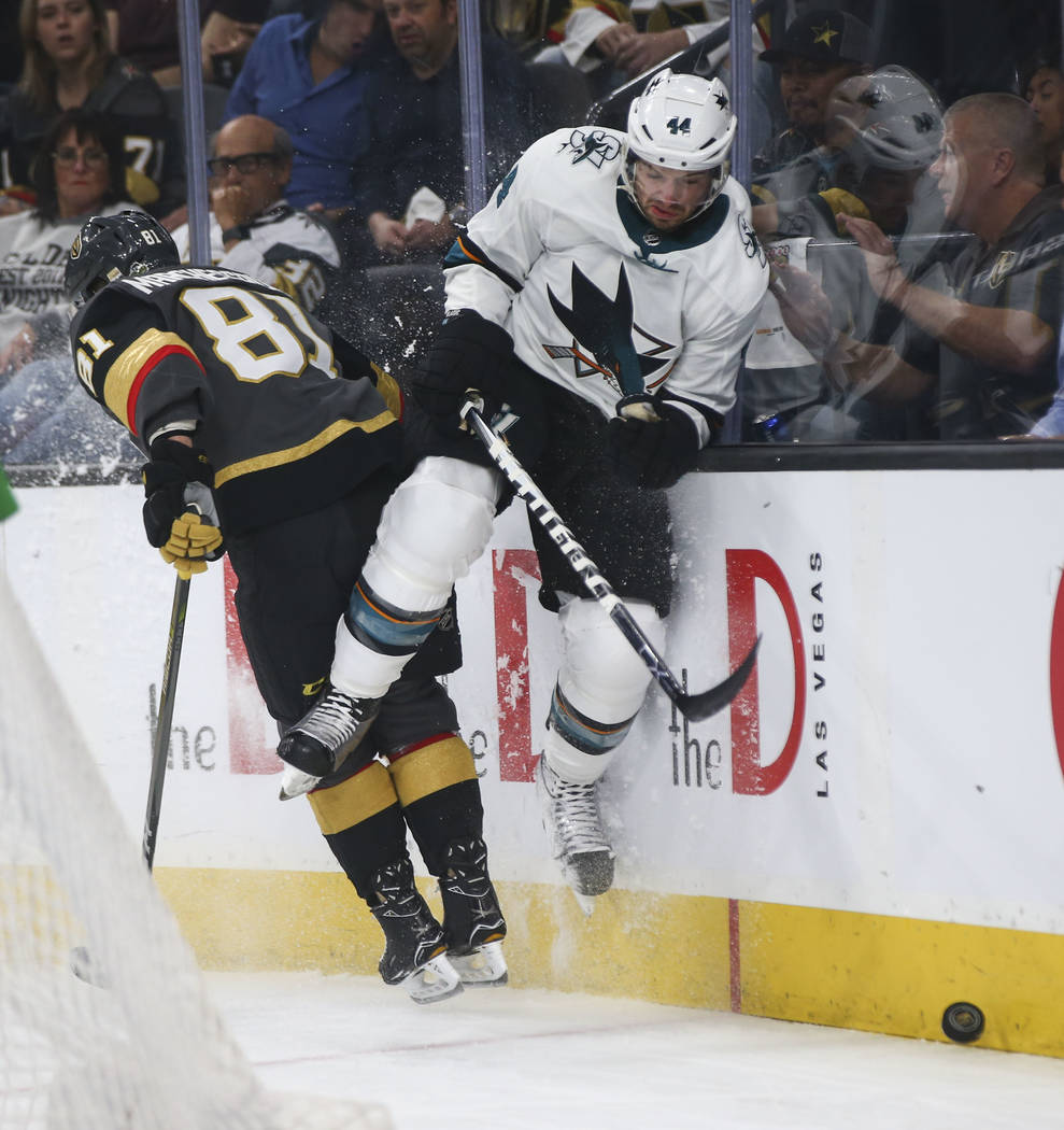 San Jose Sharks defenseman Marc-Edouard Vlasic (44) gets slammed against the glass by Golden Knights center Jonathan Marchessault (81) during the first period of Game 5 of an NHL hockey second-rou ...