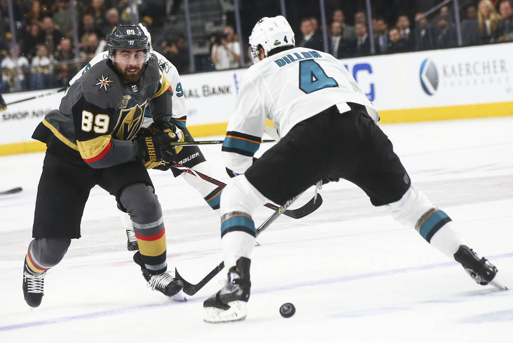 Golden Knights right wing Alex Tuch (89) moves the puck against San Jose Sharks defenseman Brenden Dillon (4) during the first period of Game 5 of an NHL hockey second-round playoff series at T-Mo ...
