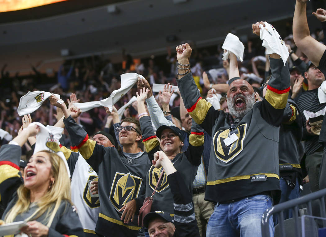 Golden Knights fans celebrate a goal by Alex Tuch, not pictured, during the second period of Game 5 of an NHL hockey second-round playoff series against the San Jose Sharks at T-Mobile Arena in La ...