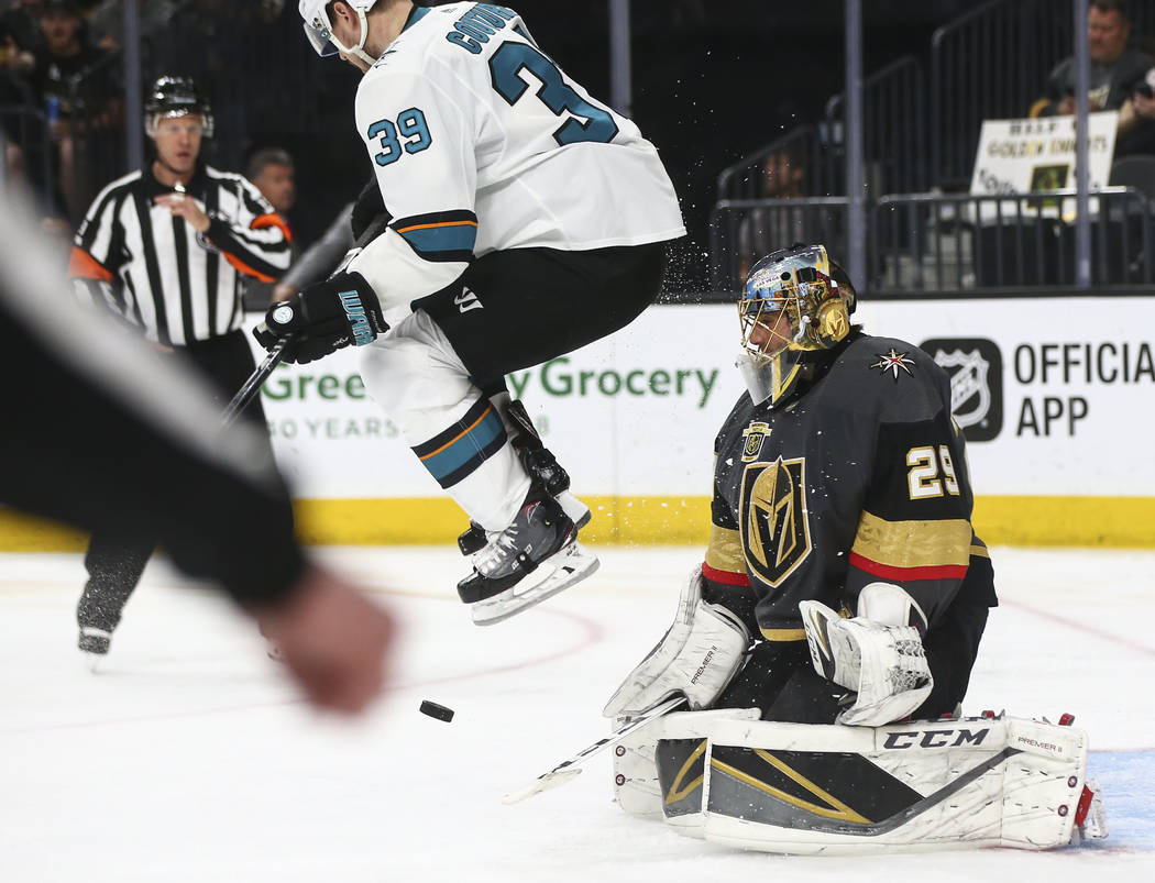 San Jose Sharks center Logan Couture (39) jumps out of the way of the puck as Golden Knights goaltender Marc-Andre Fleury (29) defends during the second period of Game 5 of an NHL hockey second-ro ...