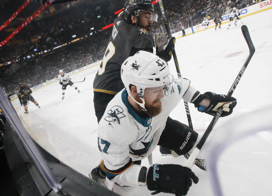 Golden Knights right wing Alex Tuch (89) and San Jose Sharks defenseman Joakim Ryan (47) chase the puck during the first period of Game 5 of an NHL hockey second-round playoff series at T-Mobile A ...