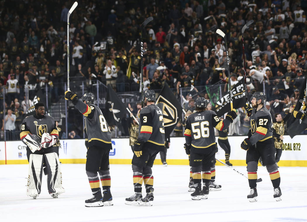 Golden Knights players celebrate their win over the San Jose Sharks in Game 5 of an NHL hockey second-round playoff series at T-Mobile Arena in Las Vegas on Friday, May 4, 2018. Chase Stevens Las ...