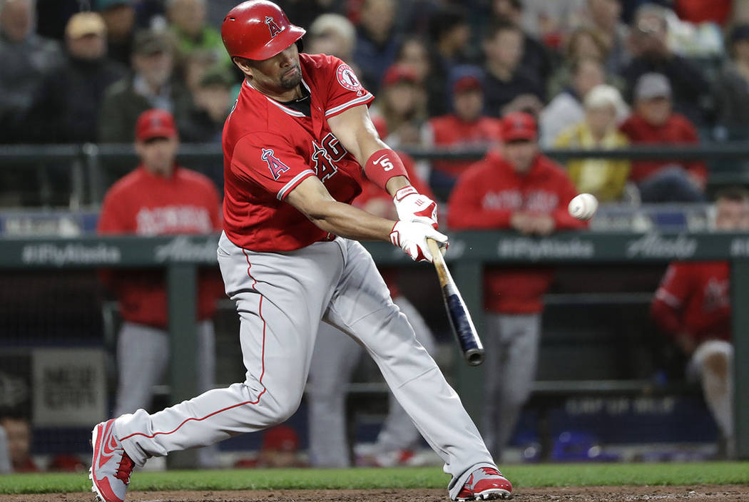 Los Angeles Angels' Albert Pujols singles against the Seattle Mariners in the fifth inning of a baseball game Friday, May 4, 2018, in Seattle. The hit was his 3,000th career hit. (AP Photo/Elaine ...