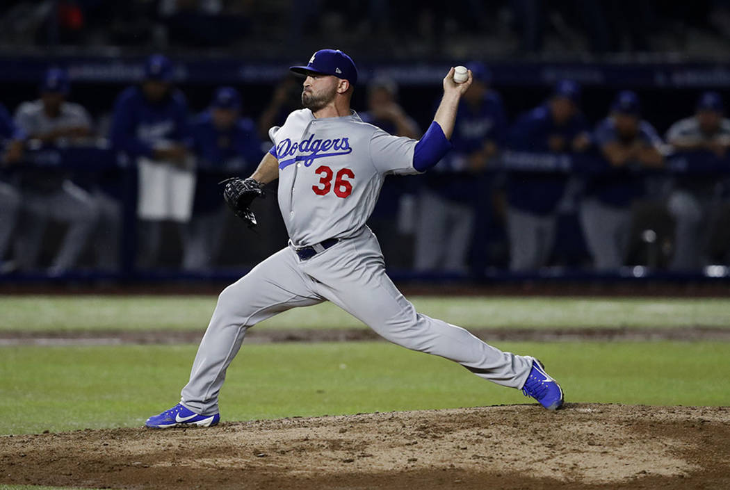 Los Angeles Dodgers relief pitcher Adam Liberatore throws to a San Diego Padres during a baseball game in Monterrey, Mexico, Friday, May 4, 2018. (AP Photo/ Eduardo Verdugo)